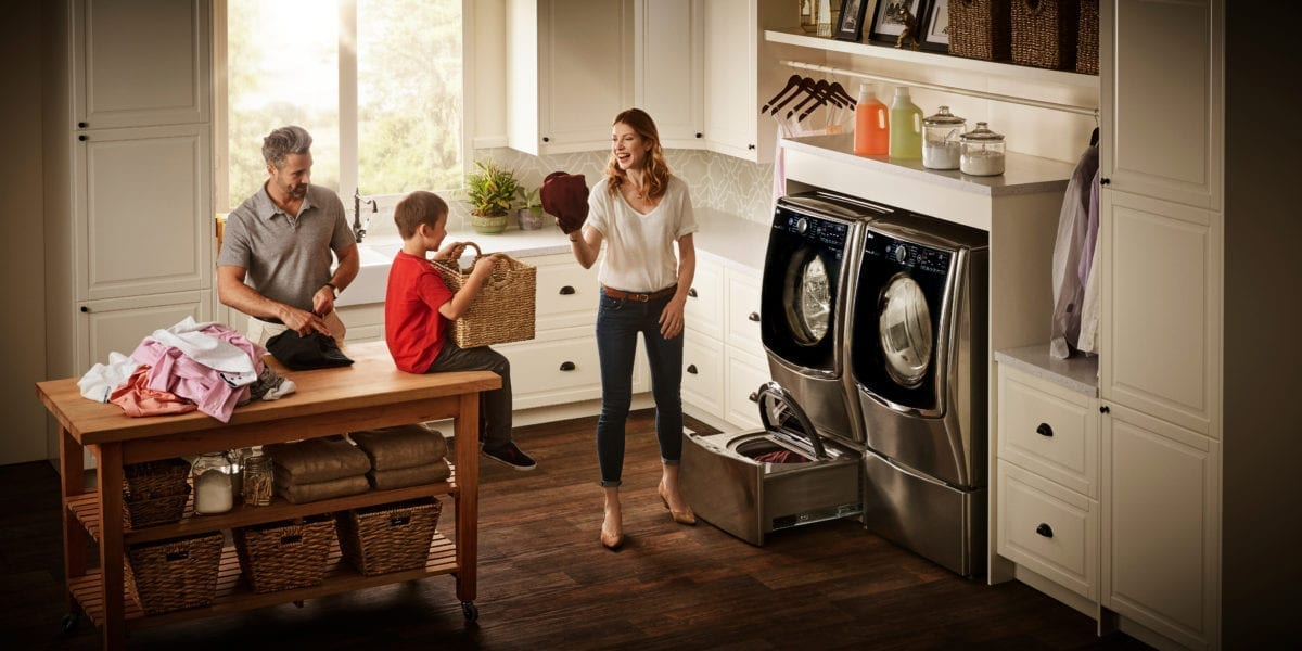 family sharing laundry tricks and tips in the laundry room with LG twin system